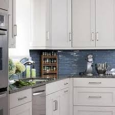 Blue Kitchens With White Cabinets White And Blue Kitchen Features White Cabinets Adorned With Satin