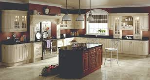 traditional cream kitchen units surround this dark walnut kitchen