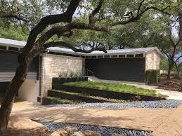 mid century modern ranch exterior stone gray metal stucco modern