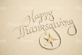 happy thanksgiving message in sand w starfish stock photo