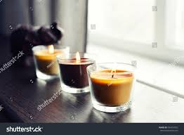 home interiors candles cozy candles on wooden table home stock photo 594773555