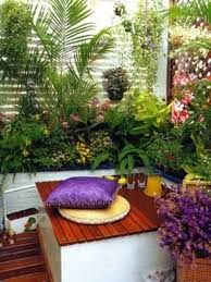 balcony garden design ideas lounge white chairs on concrete tiled