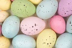 speckled easter eggs speckled easter eggs in a row on grass sky background stock photo