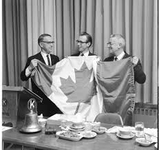 ontario kiwanis present canadian flag to ann arbor kiwanis club