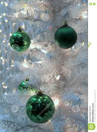 colorful green ornaments and blinking lights on white