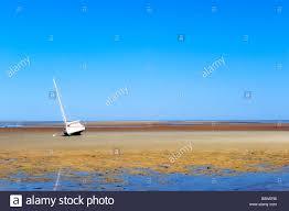 sailboat on a tidal flat brewster cape cod ma usa stock photo
