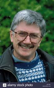 grey hair in 40 s man in his late 40s wearing glasses moustache grey hair stock