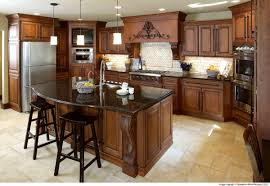 beautiful kitchen featuring showplace cabinets with custom corbels