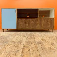 walnut europly console with colored laminate and walnut turned