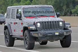 camo jeep cherokee wrangler jl caught in skintight camo reveals more details off