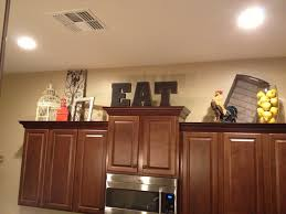 inspiring decorating ideas for above kitchen cabinets about house