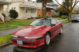 Old Parked Cars 1990 Plymouth Laser