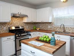 wood countertops white cabinets black backsplash throughout