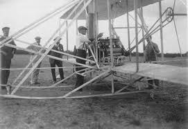 wilbur wright adjusts the engine of his aircraft france 1908