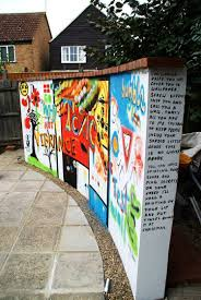 everyone should have an awesome art wall like this in their backyard