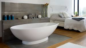 Laminate Flooring For Bathroom Oval White Acrylic Bathtub And Grey Wooden Shelf With Faucet On