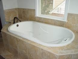 bathroom rectangle bathtub with steel rain head shower on brown bathtub for corner excerpt