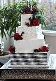 tier square white wedding cake with red roses slight offsets and