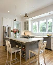kitchen island with cooktop and seating open and airy kitchen with seating around a cooktop peninsula