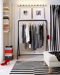 modern walk in wardrobe with black clothes rack organizing with