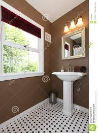brown small bathroom with antique sink and tiles stock image