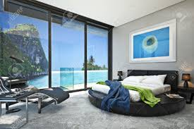 modern bedroom with a view of a magnificent seaside ocean cove