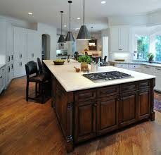 kitchen island with cooktop kitchen transitional with beige tile