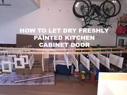 How To Spray And Let Dry Freshly Painted Kitchen Cabinet Door NO - Painted kitchen cabinet doors