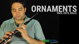 flute lesson ornaments taps cuts and rolls