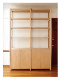Bookcase Cupboard High Low Wooden Bookcase With Cabinets Remodelista
