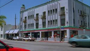 art deco balcony day hold art deco style three story corner small apartment building