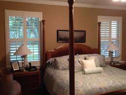 gorgeous plantation shutters dress up this master bedroom