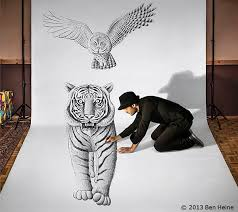 artist sketches and poses with his 3d drawings designtaxi com