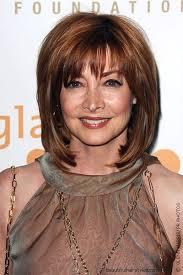 shag hairstylesfor medium length hair for women over 50 medium length hair with bangs has a shag hairstyle with