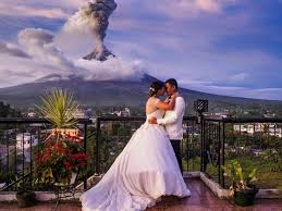 wedding backdrop philippines s stunning wedding pics as mayon volcano erupts in the