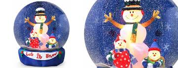Blow Up Christmas Decorations Grinch by Giant Inflatable Snow Globes They Actually Snow Inside The