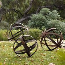 photo of steel garden decor iron sphere rusted in garden ornaments
