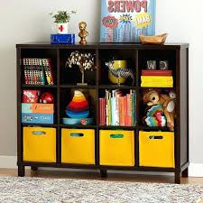 nursery bookshelf yellow wooden floor brown wicker rattan cube