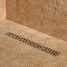 bathroom cozy travertine tile floor with linear shower drain and
