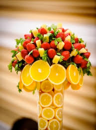 edible flower arrangements lemons at bottom of vase can be part of greeting guests goa