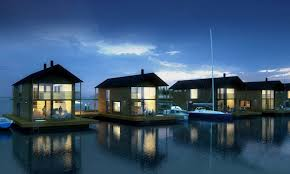 fascinating design of floating lake homes with boat and terrace