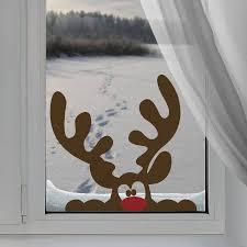 peeping reindeer window sticker by nutmeg notonthehighstreet
