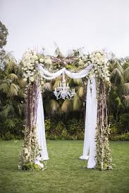 vintage santa barbara garden wedding lawn arch and chandeliers