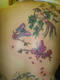 beautiful picture of birds butterflies and flowers tattoo on the back