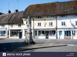 king alfred statue in the market place and thatched shop buildings king alfred statue in the market place and thatched shop buildings in the village of pewsey wiltshire england