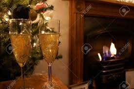 Christmas Tree Wine Bottles 2 Wine Glasses Shown By A Christmas Tree And A Fire Stock Photo