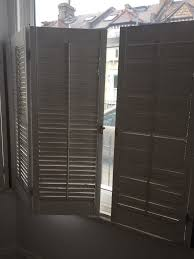 wooden cafe style shutters for bay windows in east dulwich