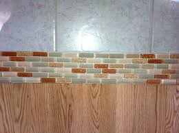 glass tile transition between floors instead of wood or marble