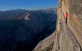 narrow picture ledge picture free climber alex honnold resting on a narrow ledge free