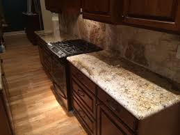 the rock backsplash next to this sienna beige granite is jaw